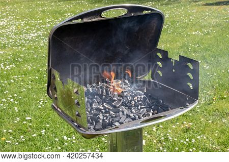 An Hot Burning Empty Charcoal Barbecue With Open Fire. Preparing Delicious Outdoor Barbecue On A Gre