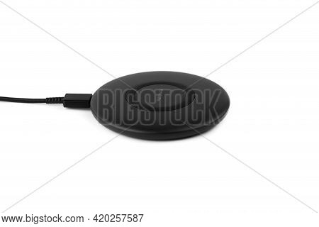 Wireless Charging For A Smartphone On A White Background. Fast Wireless Charger Close-up.