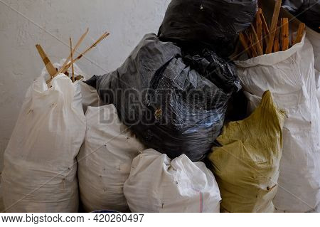 Bags With Construction Waste And Wood. Full Debris Of Construction Debris, Garbage Bricks And Materi