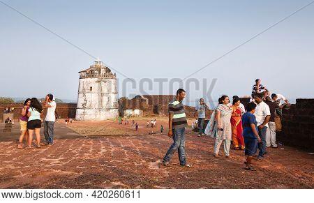 Panaji, India - November 06, 2011. Indian Tourists Visiting Aguada Fort, An Ancient Portuguese Coast