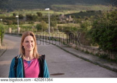 Woman Walking Away Through Alley At The Sunset