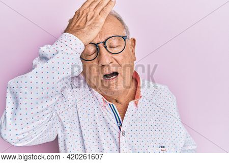 Senior caucasian man wearing casual clothes and glasses surprised with hand on head for mistake, remember error. forgot, bad memory concept.