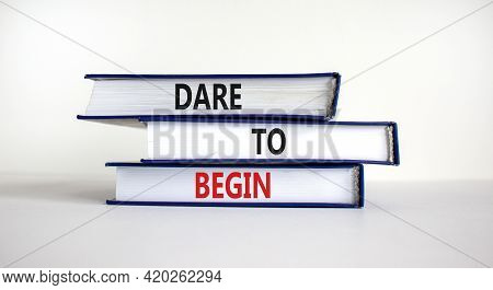 Dare To Begin Symbol. Books With Words 'dare To Begin'. Beautiful White Background. Business, Dare T
