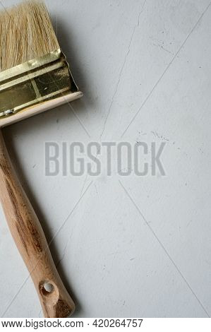 Brush For Drawing With A Wooden Handle On A Light Background. Brush With A Wooden Handle On A Light