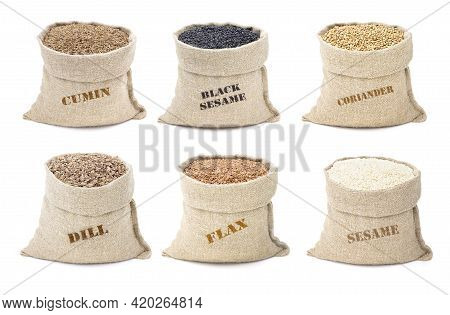 Set Of Spices In Sacks Isolated On A White Backrgound.sesame And Black Sesame. Cumin And Dill. Flax