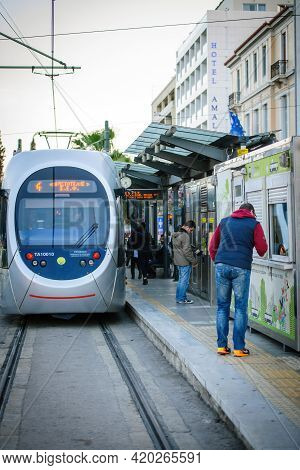 Athens, Greece - Mar 29, 2016: Tramway Station In Central Athens With Commuters People Buying Ticket