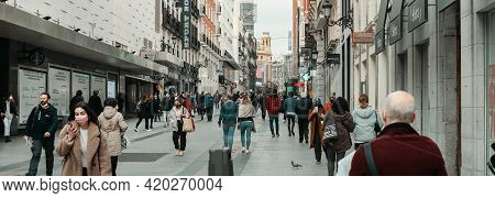Madrid, Spain - March 5, 2021: Busy Street Of Calle Preciados. Crowd Of People In Face Masks Due Cor