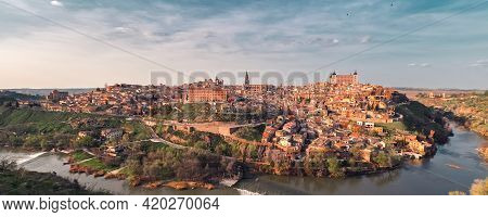 Distant View Toledo Historical Picturesque City Surrounded By Tagus River Located On Hilltop, Cloudy