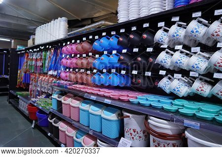 Shelves In The Store With Plastic Utensils. Rack With Miscellaneous Household Goods. Sale, Trade. Ba