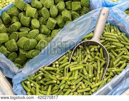 Frozen Spinach And Green Beans In A Box On A Store Counter. Frozen Spinach And Green Beans In A Bask