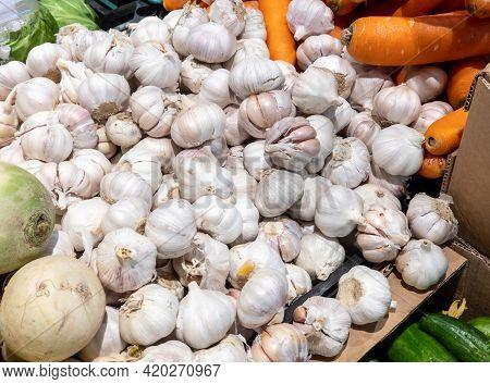 Fresh Garlic On Supermarket Vegetable Shelf. Vegetable Department In A Supermarket.