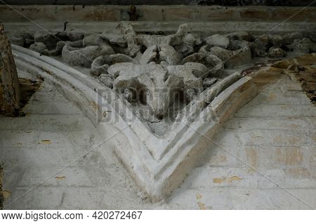 The Classical Facade Of The Old House. Ancient Plaster. The Castle Building Is Decorated With Carved