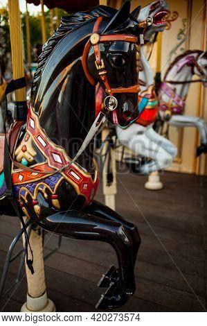 Retro Carousel White, Black Horse. Old Wooden Horse Carousel. Carousel Horses On Vintage, Retro Carn