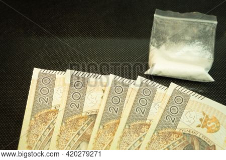 Polish Money And A Bag Of Drugs. White Powder In A Bag And Zlotys. Drug Fight, Drug Money Transfer