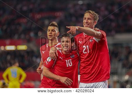 VIENNA,  AUSTRIA - OCTOBER 16:  Marc Janko (#21 Austria) and Zlatko Junozovic (#10 Austria) celebrate after a goal during the WC qualifier soccer game on October 16, 2012 in Vienna, Austria.