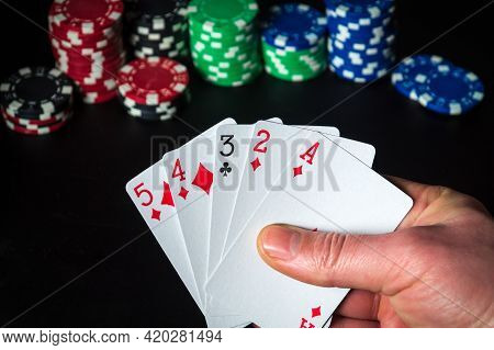 Poker Cards With High Card Combination. Close Up Of A Gambler Hand Is Holding Playing Cards In Casin