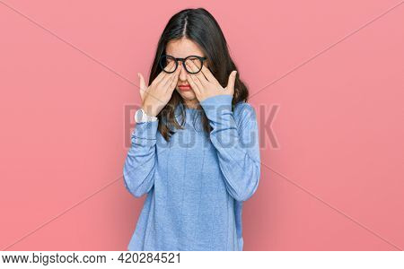 Young beautiful woman wearing casual clothes and glasses rubbing eyes for fatigue and headache, sleepy and tired expression. vision problem