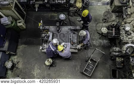 Engineer Team Are Working In Workshop Room, Technician Are Fixing And Repairing The Part Of Machine