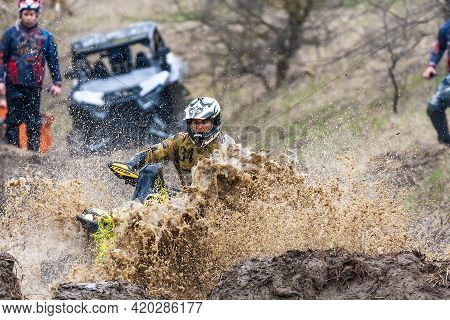 Afipsip, Russia - October 31, 2020: Sportsman On Brp Quad Bike Drives Splashing In Dirt And Water At