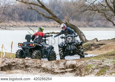 Afipsip, Russia - October 31, 2020: Sportsmen On Quad Bikes Finished Race At Mud Racing Contest. Atv