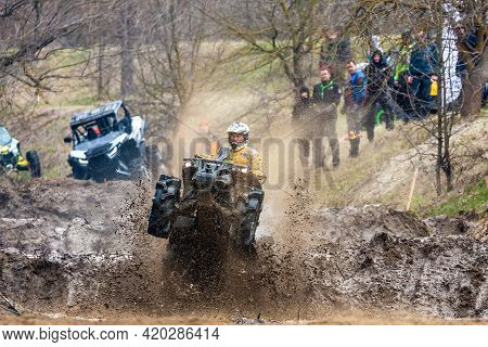 Afipsip, Russia - October 31, 2020: Sportsman On Quad Bike Drives Splashing In Dirt And Water At Mud