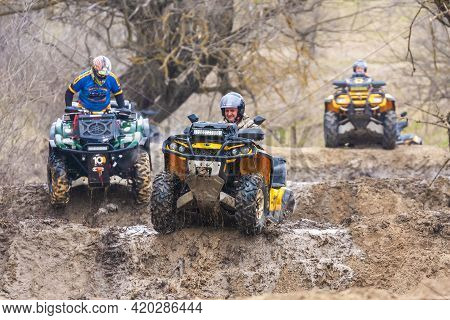 Afipsip, Russia - October 31, 2020: Sportsmen On Quad Bikes Drive Splashing In Dirt And Water At Mud
