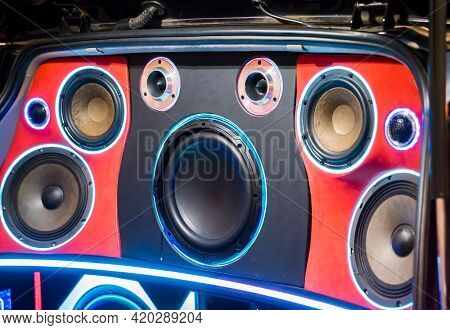 colorful lights of stereo and speakers in car in the night