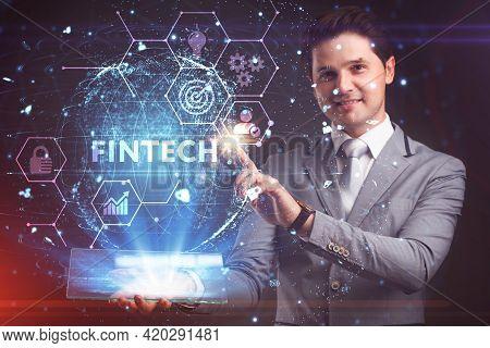 Fintech -financial Technology Concept.young Businessman  Select The Icon Fintech On The Virtual Disp