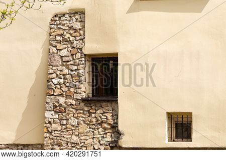Plastered Wall With Masonry. Combinations Of Old Stone And Plastered Walls With Windows. Windows Wit