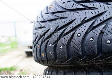 Old Winter Car Tire. Studded Rubber Close-up. Additional Spikes In The Tire. Winter Car Tire Repair.