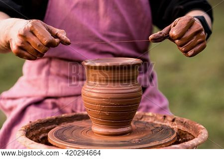 Job Is Done. Young Pottery Man With Finished Handmade Clay Product. Professional Male Potter Work Wi