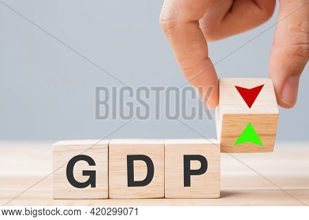 Business Man Hand Change Wood Cube Block With Gdp Text (gross Domestic Product) To Up And Down Arrow