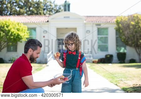 School Boy Going To School With Father. Healthy School Breakfast For Child. Food For Lunch, Lunchbox