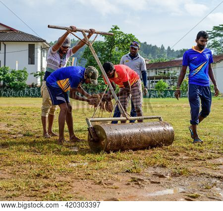 Galle, Sri Lanka - 04 17 2021: Players And Staff Preparing Cricket Pitch And The Ground After Heavy