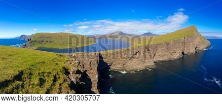 View On The  Traelanipan  and Bosdalafossur waterfall  And Sorvagsvatn Lake at Sunny Day, Vagar, Faroe Islands, Denmark.  A Lake Above the Ocean