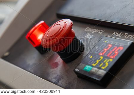 Large Red Button For Turning The Machine On And Off On The Weaving Plant For The Production Of Plast