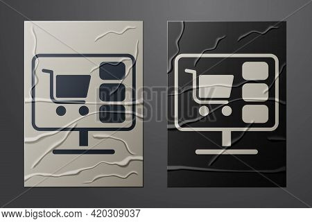 White Shopping Cart On Screen Computer Icon Isolated On Crumpled Paper Background. Concept E-commerc