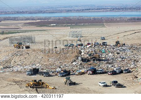 Nampa, Idaho - March 27, 2021:trucks Dumping Their Waste At The County Landfill