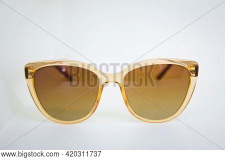 Elegant Sunglasses Isolated On The White . Sunglasses Isolated, Cutout . Modern Brown Sunglasses Iso