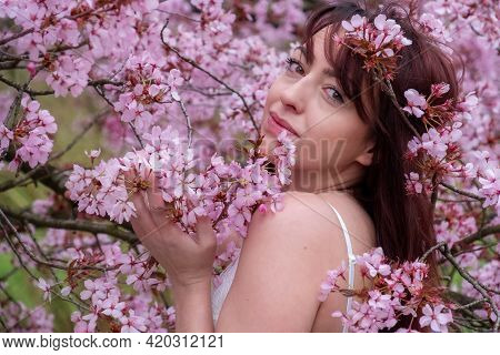 Sensual, Seductive, Portrait Of A Sexy, Young, Innocent, Brunette Woman In White Dress In Pink Flowe