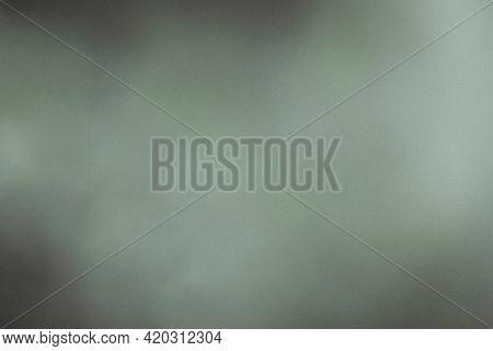 Abstract greenish gray misty background