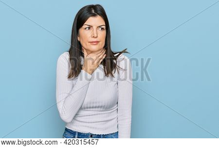 Beautiful brunette woman wearing casual clothes touching painful neck, sore throat for flu, clod and infection