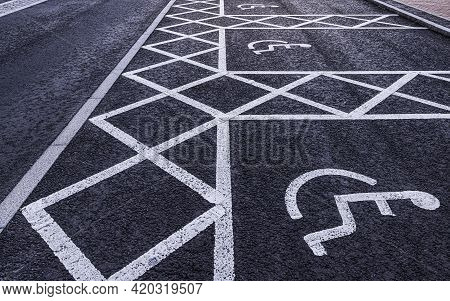 Disabled Parking Spaces Painted On A Tarmac Road