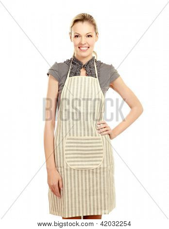 Beautiful happy young woman wearing kitchen apron , isolated on white