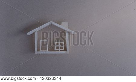 Wooden Model House On Brown Background. Background For Copy Space. Mortgage Loan Approval Home Loan