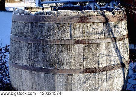 Old Giant Wooden Barrel Hoar Frosted In Backyard