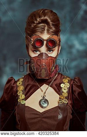 Portrait of a beautiful victorian steampunk lady in a mask on a grunge background. Fantasy world, scientific inventions.