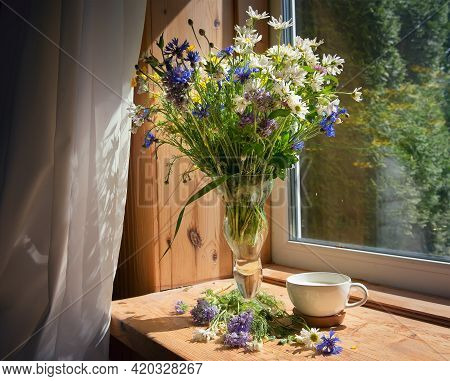 A Soft, Concentrated Bouquet Of Flowers In An Old Vase On The Windowsill In The Morning Sun. Next To