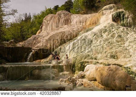 People Taking Thermal Baths In Free Outdoor Thermal Pools In Bagni Di San Filippo, Tuscany In Italy