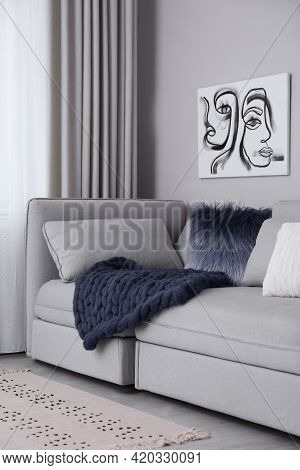 Living Room Interior With Knitted Merino Wool Blanket On Sofa
